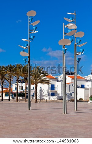 View of town square with modern lamps. Manta Rota, Algarve, Portugal - stock photo