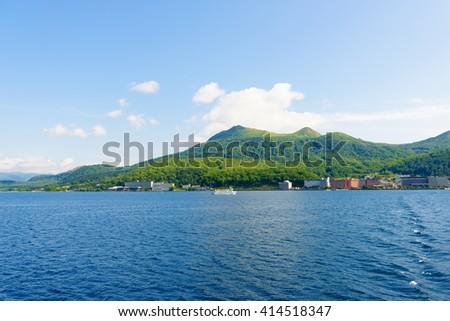 View of Toya City from Toya Lake (Toyako) in Hokkaido, Japan. - stock photo