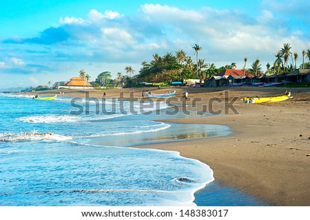 View of traditional Balinese fisherman village at sunrise - stock photo
