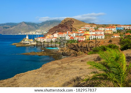 View of traditional village houses and port on east coast of Madeira island, Portugal  - stock photo