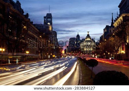 View of traffic in the streets of Madrid at dawn. Streets of Madrid - stock photo