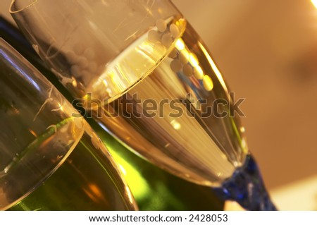 view of two flute glass and a bottle of Champagne - stock photo