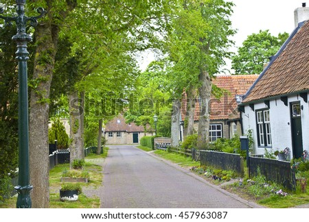 View of typical historic street in Ameland, The Netherlands - stock photo