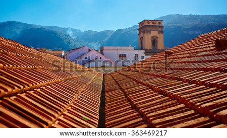 view of typical vintage house with tile roof - stock photo