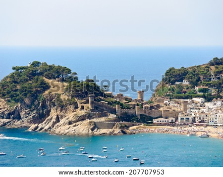 view of urban beach and Vila Vella monument in town Tossa de Mar, Costa Brava, Catalonia, Spain - stock photo