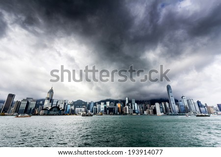View of Victoria harbor just before a tropical cyclone  During summer, typhoons regularly skirt the city, causing varying degrees of damage including injuries and deaths  - stock photo