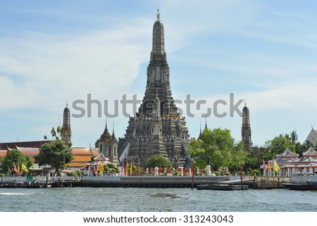 View of Wat Arun Buddhist Temple on the Chao Phraya River in Bangkok Thailand - stock photo