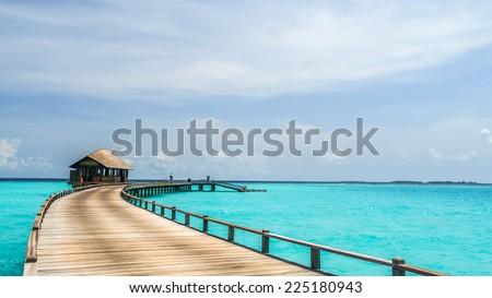 view of water bungalow in irufushi island,  maldives - stock photo