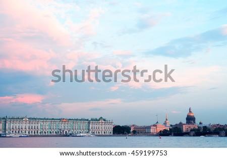 View of Winter Palace across Neva river at sunset, Saint Petersburg, Russia - stock photo