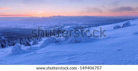 View of winter wonderland during the sunset time, panoramic picture. - stock photo