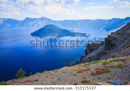 View of Wizard Island in the Sapphire Blue Waters of Crater Lake, Oregon - stock photo