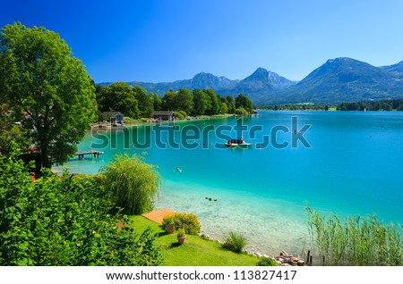 View of Wolfgangsee lake on summer day with Alps mountains in the background, Austria - stock photo