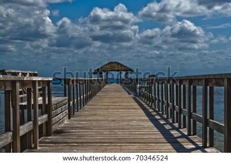 View of wooden beach pier in Roatan, Honduras - stock photo