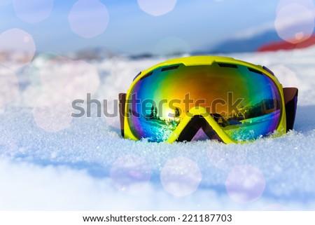 View of yellow ski mask on white icy snow - stock photo