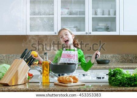 view of young beautiful girl cooking at the kitchen - stock photo
