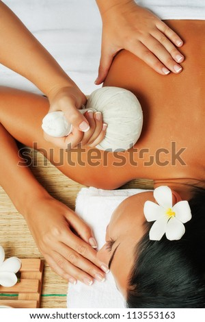 view of young beautiful woman in spa environment - stock photo