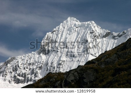 View on a famous snowcapped Chacraraju peak in Andes. Peru - stock photo
