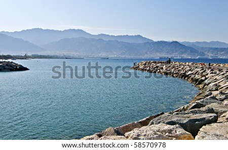 view on Aqaba city from the dam of northern beach of Eilat - stock photo