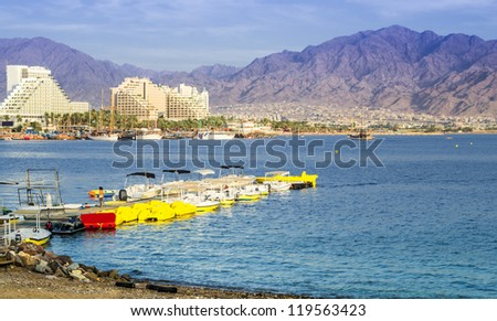 View on beaches of Eilat - famous resort and recreation city of Israel - stock photo