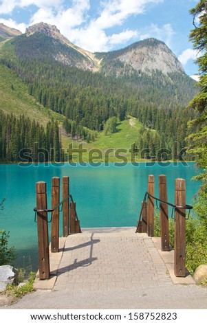 View on beautiful Emerald Lake and a mountain range of the Rocky Mountains in Alberta, Canada - stock photo