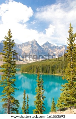 View on beautiful Moraine Lake and a mountain range of the Rocky Mountains in Alberta, Canada - stock photo