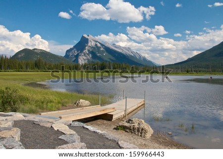 View on beautiful Vermillion Lakes near Banff, Alberta, Canada, with the Canadian Rocky Mountains in the background - stock photo