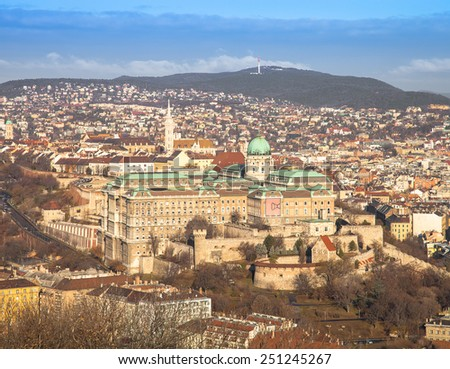 View on Budapest from Gellert Hill, Hungary. Houses, river Danube in the background of mountains and clear blue sky. - stock photo