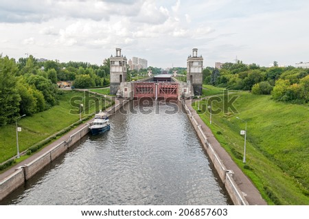 View on canal with yacht and closed shipping lock against skyline. Moscow, Russia.   - stock photo