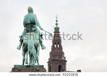 view on Christiansborg palace tower and Statue of Absalon in Copenhagen, Denmark - stock photo
