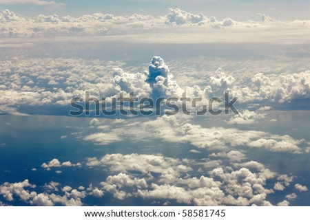view on cloudscape from airplane window - stock photo