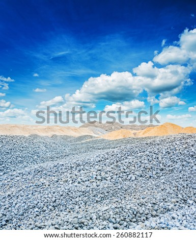 view on construction place gray granite gravel and sand  - stock photo