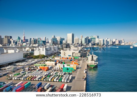 View on container ship in the harbor, Sumida River , Odaiba,  Tokyo , Japan. - stock photo