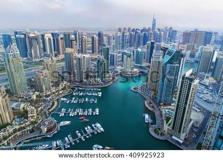 View on Dubai Marina skyscrapers and the most luxury superyacht marina,Dubai,United Arab Emirates - stock photo
