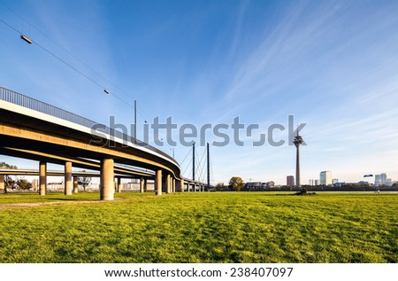 View on Dusseldorf with elevated bridge over Rhine river - stock photo