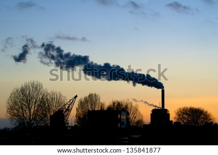 View on electrical plant from the river Waal at dusk - stock photo