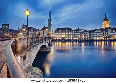 view on Fraumunster Church and Church of St. Peter at night, Zurich, Switzerland - stock photo