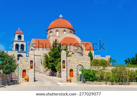 View on Greek monastery with classic red roofing, Greek Island Kalymnos, Greece - stock photo