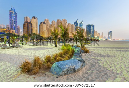 View on Jumeirah beach and Dubai Marina skyscrapers at the sunset,Dubai,United Arab Emirates - stock photo