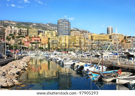 View on marina with yachts and boats and residential buildings on background in Monte Carlo, Monaco. - stock photo