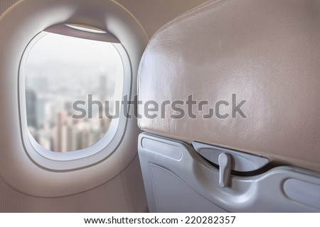View on modern city above from airplane passenger window - stock photo