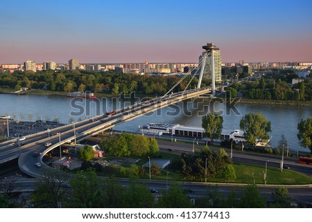 View on New bridge over Danube river from castle hill in Bratislava,Slovakia at sunset - stock photo