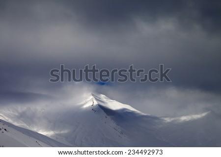 View on off-piste slope in storm clouds. Caucasus Mountains, Georgia. Ski resort Gudauri. - stock photo