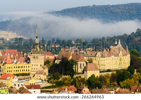 view on old city center of Sighisoara in Transylvania, Romania with the clock tower - stock photo