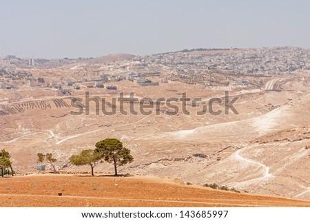 View on Palestinian city in Judean desert landscape not far from Bethlehem. Palestine, Israel.   - stock photo