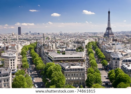 View on Paris from Arc de Triomphe. Eiffel tower on right and Tour Montparnasse on the left in background. - stock photo