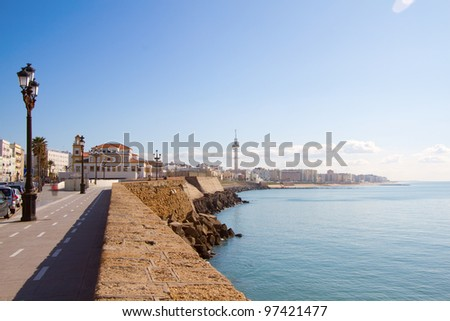 View on promenade by the sea in Cadiz, Spain - stock photo