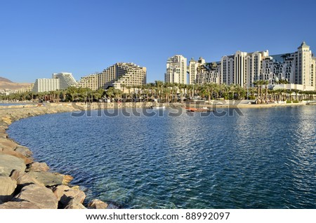 View on promenade of the northern beach of Eilat - famous resort and recreation city in Israel - stock photo