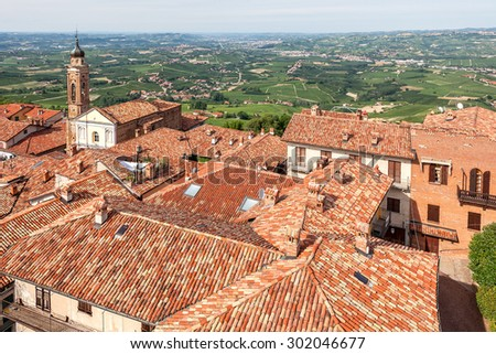 View on red roofs and green hills on background in Piedmont, Northern Italy. - stock photo
