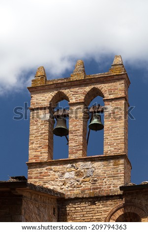 view on some of famous tower with bells in San Gimignano in Toscany in italy - stock photo