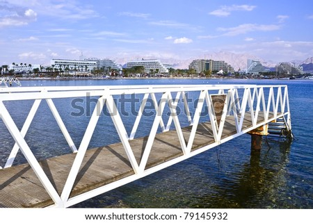 View on the Aqaba gulf, swimming bridge and resort hotels in Eilat, Israel - stock photo